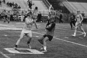 Sophomore Hannah Smith blocks an Edison High School player at the varsity girls lacrosse conference championship game on  May 21. The game ended in 15 - 5 victory for the Statesmen.