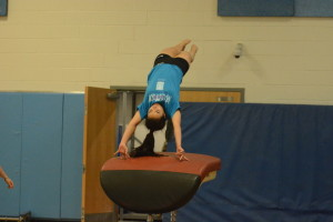 Sophomore Megumi Matsuda-Rivera performs a vault during a Nov. 16 practice. The gymnastics team's first meet will take place Dec. 7.