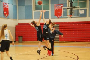 Juniors Lauren Deaver (left) and Leah Walters (right) practice tip-offs during a practice on Feb 11. Although girls varsity struggled throughout the season, ending with a 5-17 record, they still found pride in some of their other accomplishments.