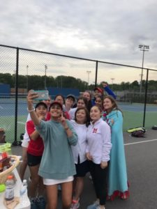 Girls varsity tennis coach Arlene Fitz-Patrick poses for a selfie with her team after winning the Capitol Conference.
