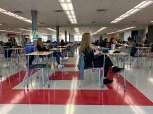 Students at Marshall High School attempt to follow social distancing guidelines while eating lunch