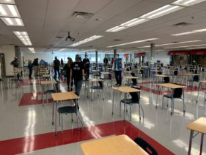 students at marshall high school practice social distancing while finding a seat for lunch