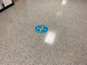 marshall high school floor stickers direct students to stay six feet apart to maintain social distancing